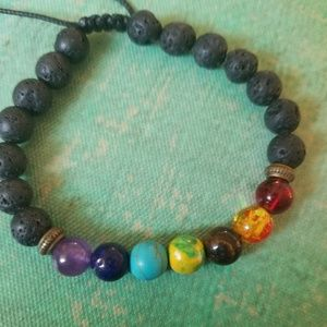Jewelry - Lava stone bracelet with chakra colored stones